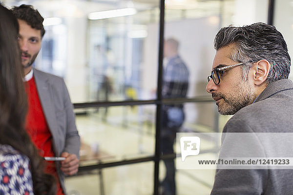 Attentive businessman listening in office