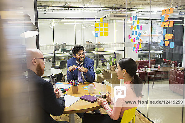Creative business people brainstorming in conference room meeting