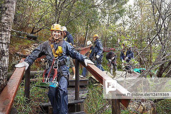 Portrait smiling woman preparing to zip line