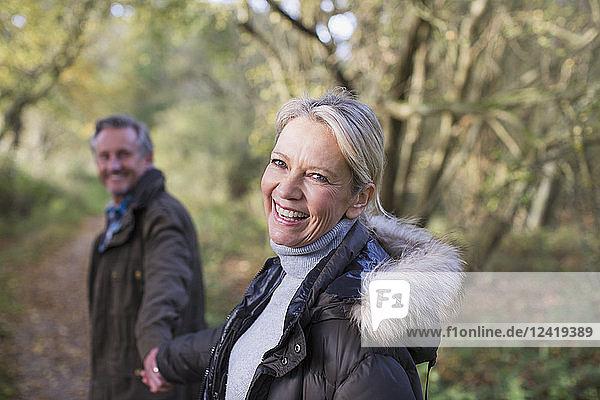 Portrait smiling,  happy mature couple holding hands in park