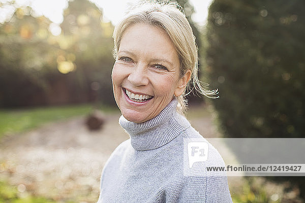 Portrait smiling  confident mature woman in backyard