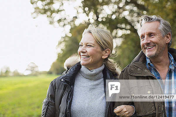 Happy,  carefree mature couple in autumn park