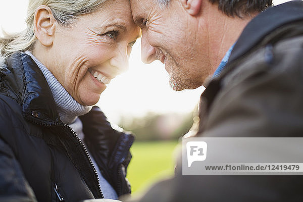 Close up affectionate  carefree mature couple head to head