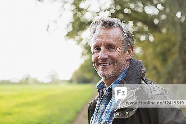 Portrait smiling  confident senior man in park