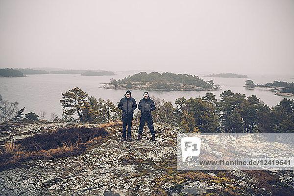 Sweden  Sodermanland  two men standing at archipelago landscape