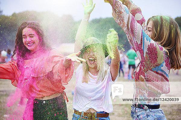 Portrait of friends at music festival  colour powder Portrait of friends at music festival, colour powder