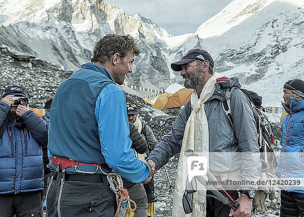 Nepal  Solo Khumbu  Everest  Sagamartha National Park  People greeting at the base camp