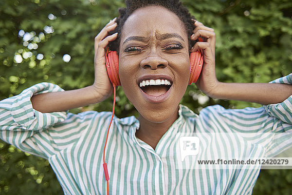 Portrait of singing young woman with headphones Portrait of singing young woman with headphones