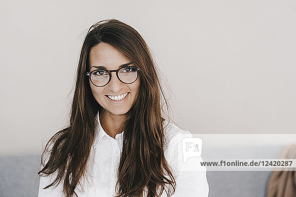 Portrait of a pretty  clever  young woman  wearing glasses