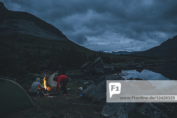 Norway  Lofoten  Moskenesoy  Young men camping at Selfjord