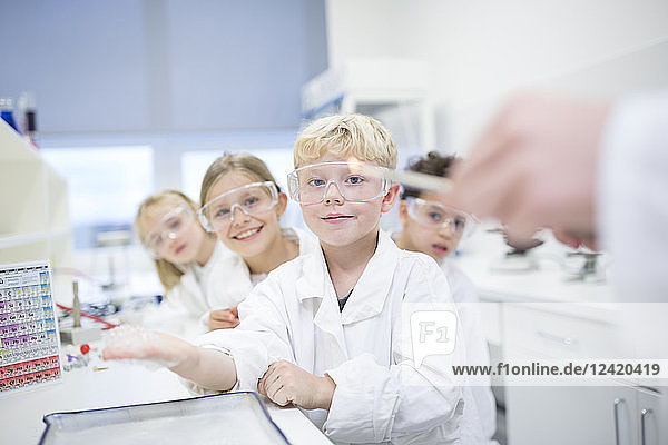 Portrait of smiling pupils in science class
