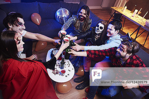 Friends toasting at Halloween party