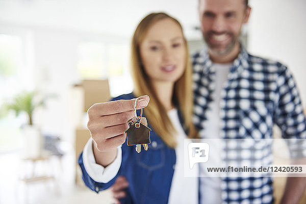 Close-up of couple holding key to new home