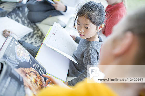 Pupils reading together in school