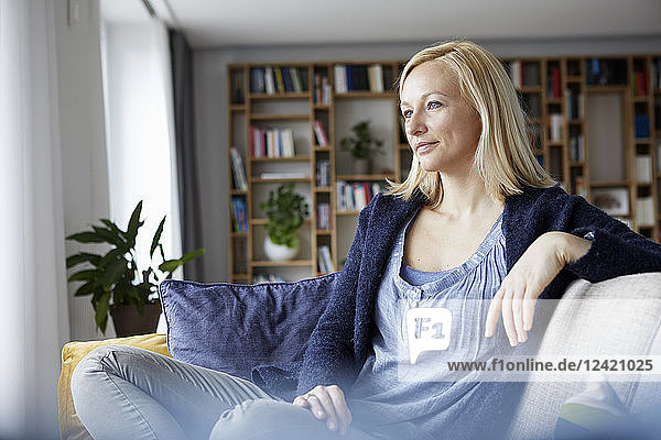 Woman relaxing at home  sitting on couch