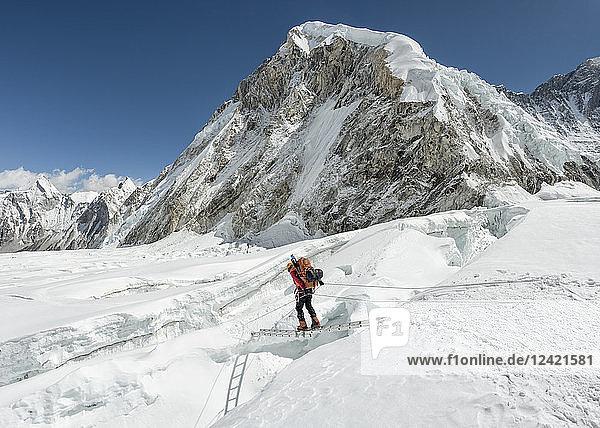 Nepal  Solo Khumbu  Everest  Sagamartha National Park  Mountaineer crossing icefall at Western Cwm