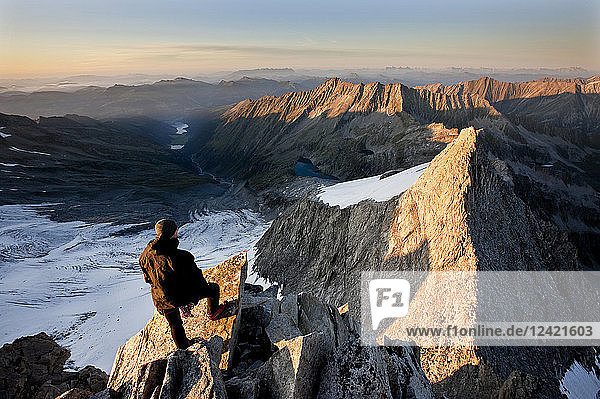 Austria  Tyrol  Zillertal Alps  View from Reichenspitze  climber at glaciated mountains at sunrise  Wildgerlostal  High Tauern National Park