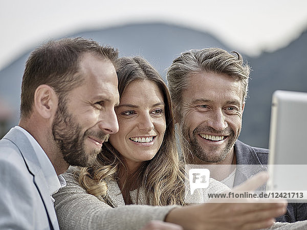 Smiling colleagues taking a selfie