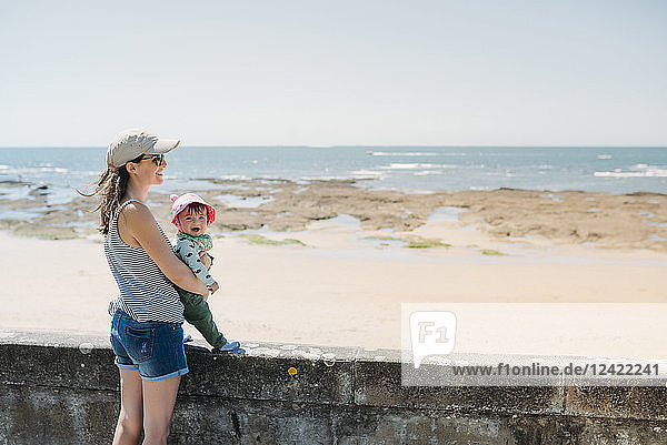 France  mother and baby at beach promenade