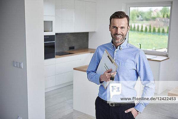 Portrait of smiling real estae agent in new apartment Portrait of smiling real estae agent in new apartment