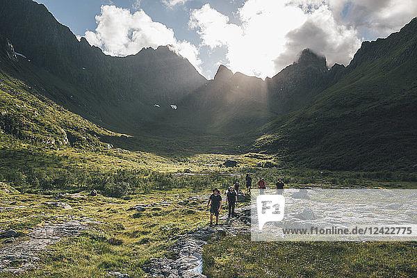 Norway  Lofoten  Young men hiking in Moskenesoy
