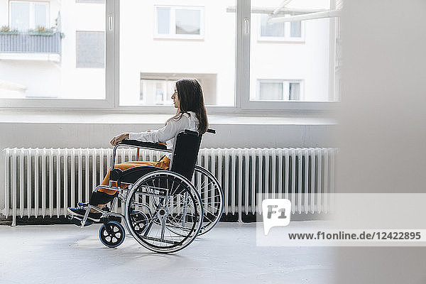 Young handicapped woman sitting in wheelchair
