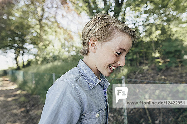 Laughing boy on forest path