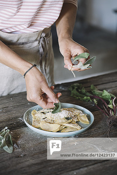 Filled ravioli on plate  sage