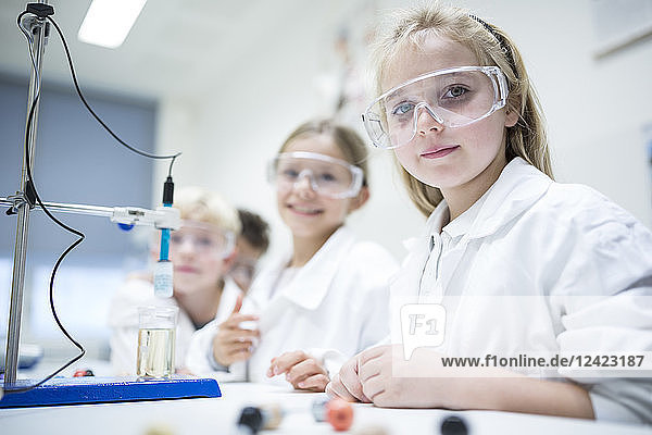 Pupils in science class experimenting