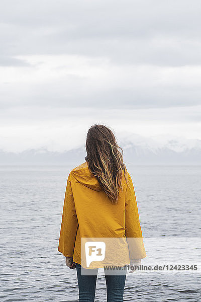 Iceland  woman standing at the sea