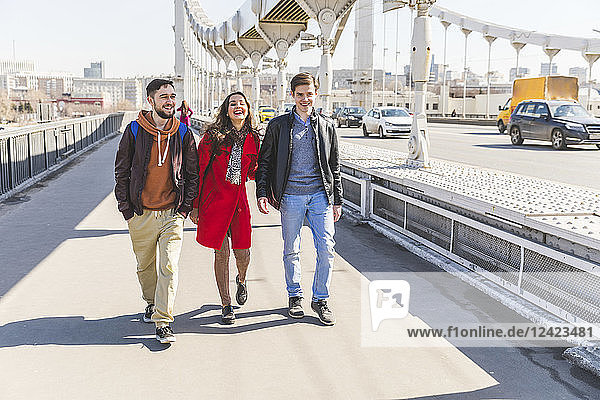 Russia  Moscow  group of friends walking over a bridge