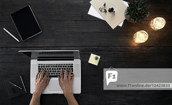 Person working in office  using laptop