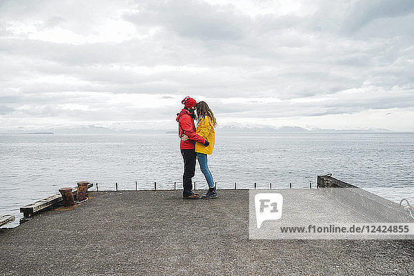 Iceland  North of Iceland  young couple standing on jetty