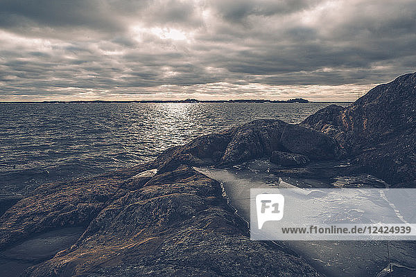 Sweden  Sodermanland  seashore under cloudy sky