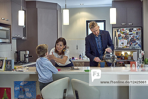 Everyday Scene of a family in kitchen at home