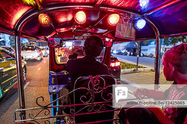 Thailand  Bangkok  boy riding Tuk-Tuk Taxi
