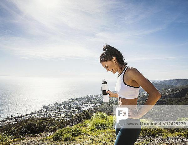 Woman in sportswear with water bottle