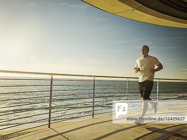 Man jogging by ocean