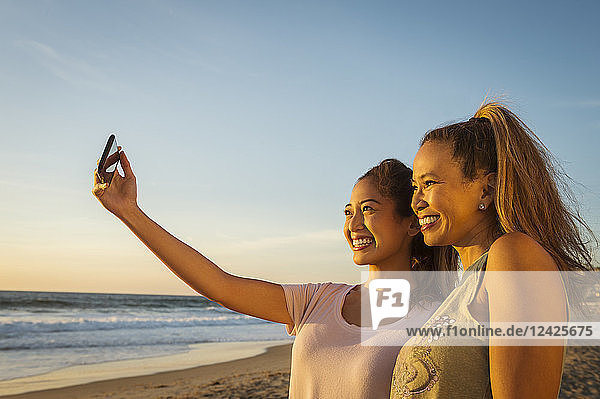 Mother and daughter taking selfie