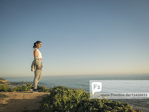 USA  California  Newport Beach  Woman standing on cliff and looking at view