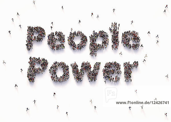'Overhead view of people forming words ''people power'''