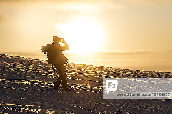 Photographer at sunset  Pallas-Yllastunturi National Park  Muonio  Lapland  Finland  Europe