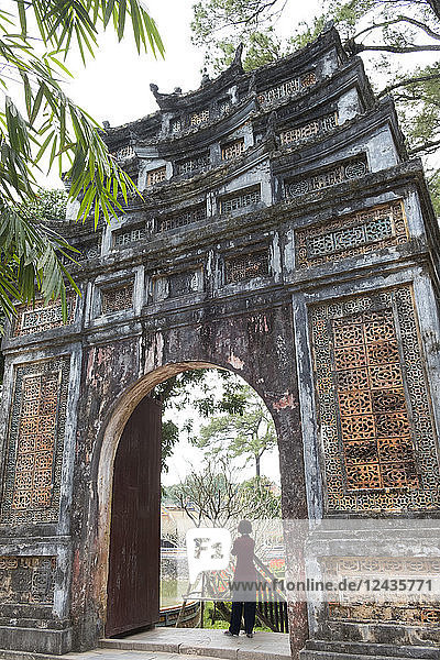 An ornately decorated gate in the grounds of the Tu Duc Tomb near Hue  Vietnam  Indochina  Southeast Asia  Asia