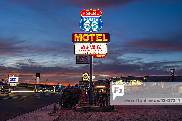 Historic Route 66 neon sign glowing at sunset  Seligman  Arizona  United States of America  North America