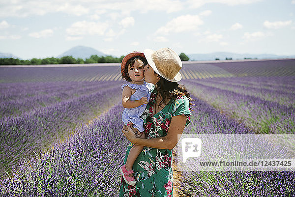 France  Provence  Valensole plateau  Mother kissing daughter in lavender fields in the summer