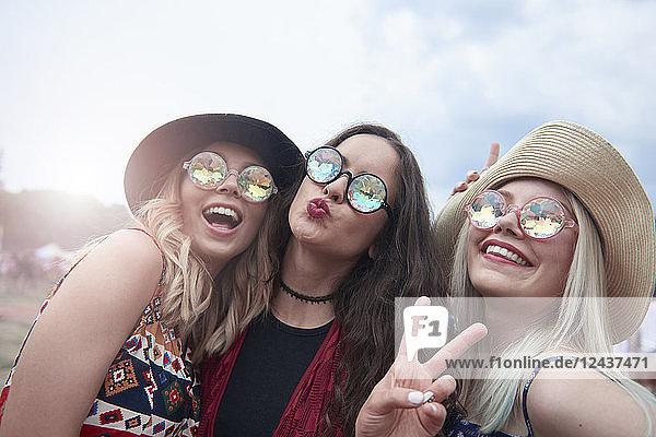 Portrait of three women having fun at the music festival