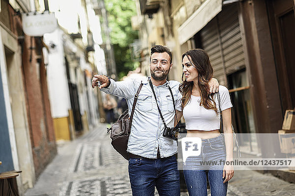 Tourist couple walking and exploring the city