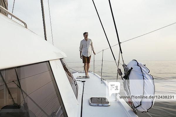 Marure man walking on catamaran Marure man walking on catamaran
