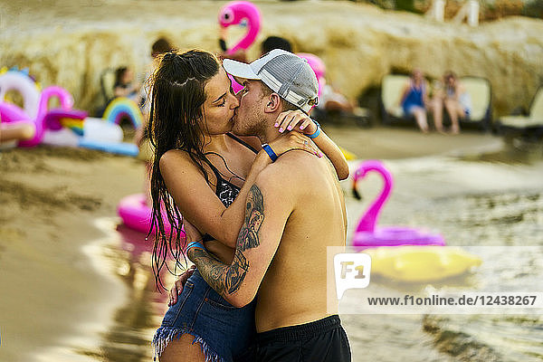 Greece  Crete  passionate lovers kissing at beach party