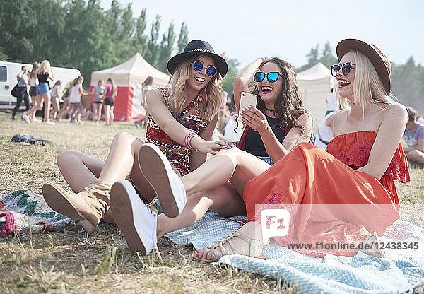 Happy friends making selfie at music festival Happy friends making selfie at music festival